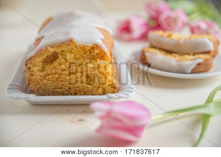 Home made carrot cake with frosting on a plate