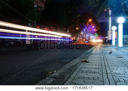 Night Traffic In The City, Car Lights In Motion Blur With Zoom Effect