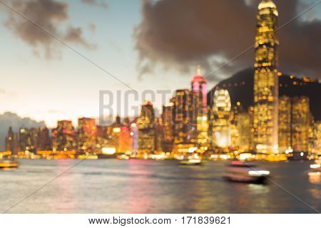 Blurred bokeh light Hong Kong city business downtown over Victoria Bay abstract background