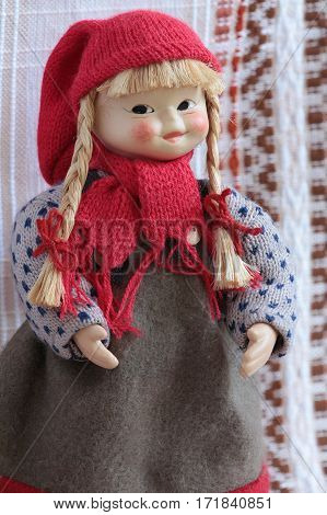 puppet in a red cap with pigtails and red bows