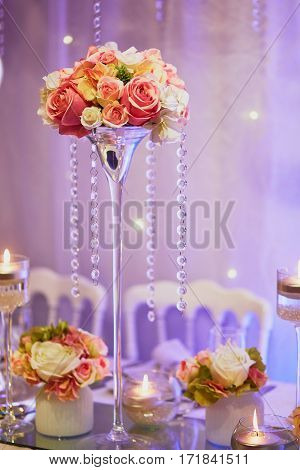 Table Set With Candles And Flowers For A Festive Event, Party Or Wedding Reception
