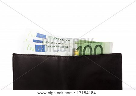 Banknotes of hundred euros sticking out of black wallet on white background. Money in cash. Closeup image.
