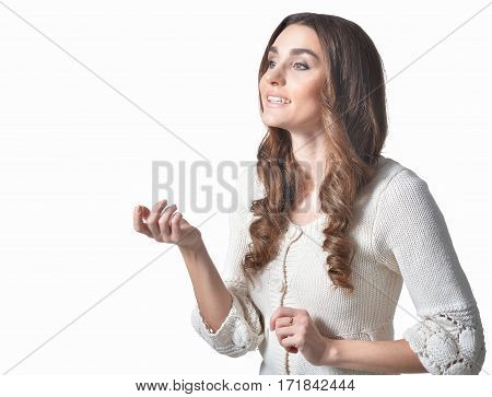 portrait of young woman gesticulating on white