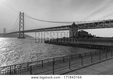 Black and White Akashi Kaikyo Bridge Longest suspension bridge over coastline Kobe Japan