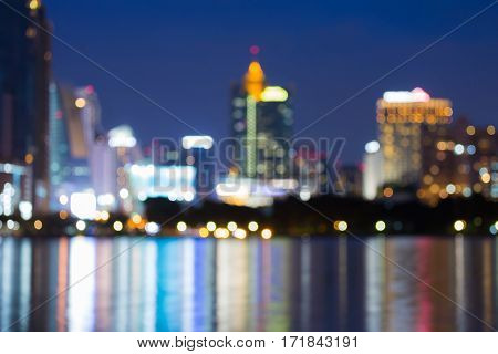 Abstract blurred bokeh city business with water reflection light background