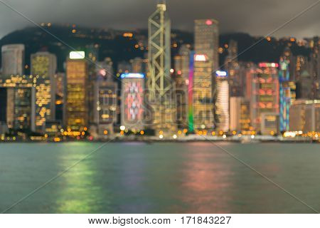 Night blurred bokeh lights Hong Kong city over Victoria Bay abstract background