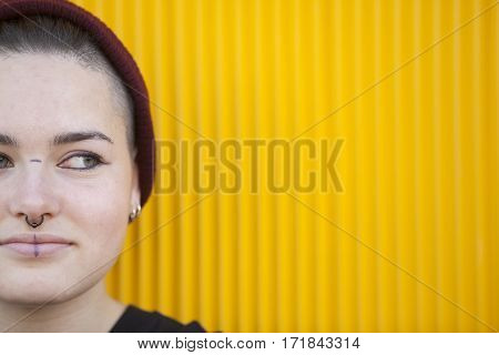 portrait of a teen lesbian woman isolated on a yellow wall
