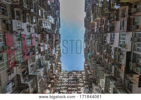 Hong Kong city apartment with blue sky background from bottom view