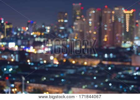 Aerial view blurred bokeh light city office building with twilight sky abstract background