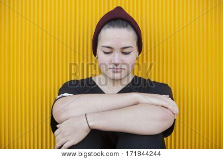 sad and thoughtful gay teenager isolated on yellow background