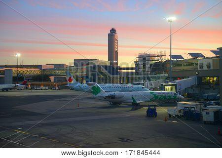 BOSTON - SEP. 26, 2015: Boston Logan International Airport at sunrise, Boston, Massachusetts, USA.