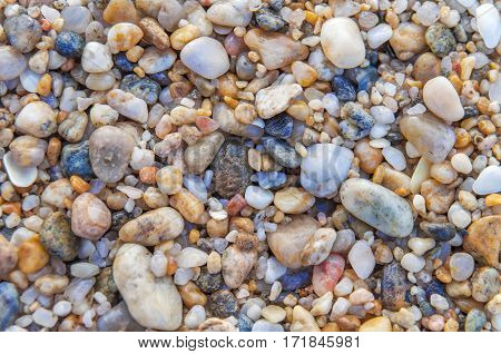 Pebbles round sea stones background close up
