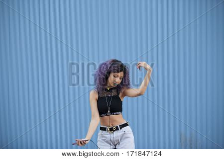 interracial teenager dancing to the music on a blue background