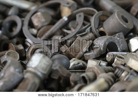 Background with the image of different close up bolts, screws and so on
