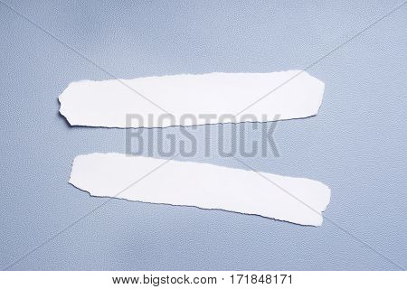 two empty pieces of paper with copy space on blue desk pad