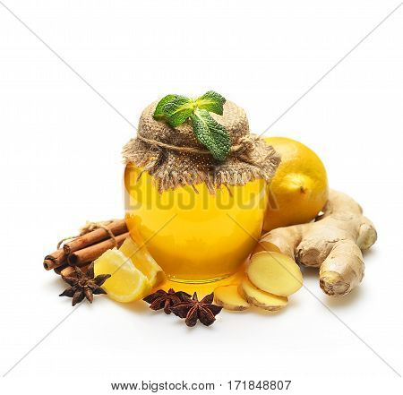 Honey, ginger, lemon and spices on a white background