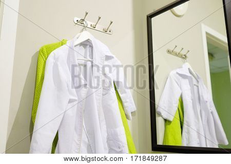 Doctor's robe on a hanger