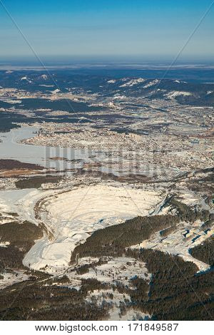 Quarry for extraction and production of talc and various types of rubble in vicinity of Miass city in winter, aerial view