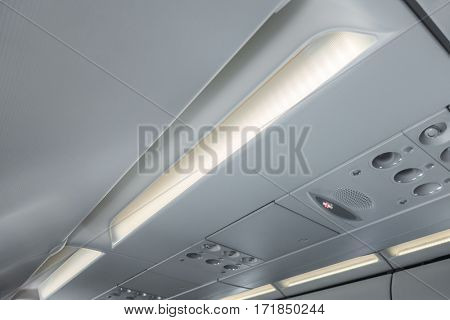 Signs panel above the seat on plane