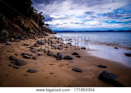 Beautiful pebble sand beach near Hobart, Tasmania, Australia