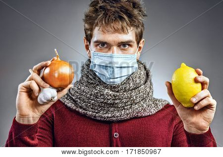 Young man in protective mask against infectious diseases and flu. Sick man knows that helping common colds. Healthcare concept