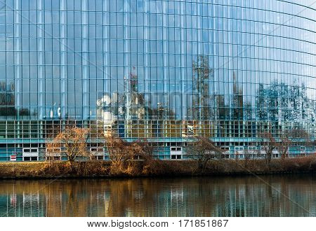 Abstract refelcection of the European Court of Human Rights in the glass facade of the European Parliament building in Strasbourg