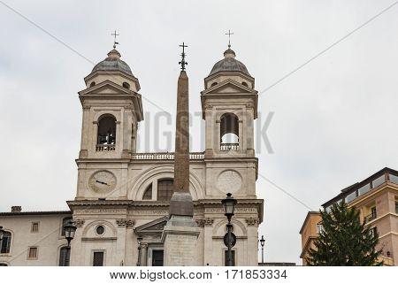 view of the church on Trinita dei Monti in Rome Italy