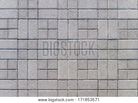 Street covered with gray concrete cubes close