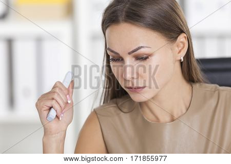 Close Up Of Woman Considering Options