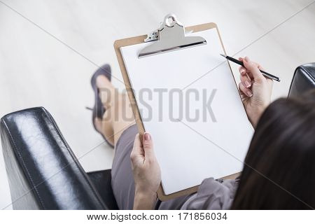 Top View Of Woman Hand With Clipboard