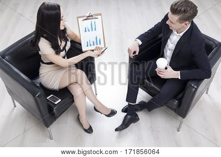 Woman Is Showing A Graph To Her Colleague