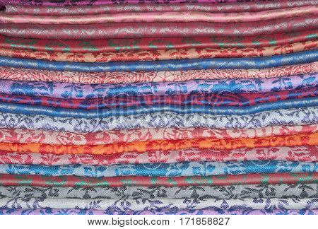 Background of eastern colorful cashmere stoles stacked