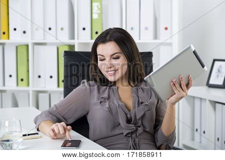 Smiling Girl With Tablet And Smartphone