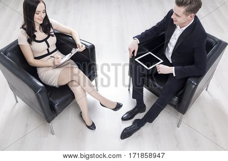 Top View Of Man And Woman In Office Armchairs