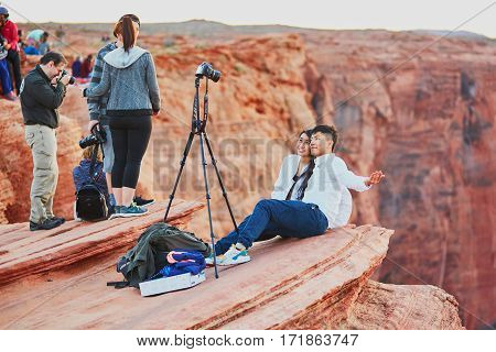 October 25, 2015 - Horseshoe Bend: Tourists Taking Photo On The Precipice Of Horseshoe Bend, In The