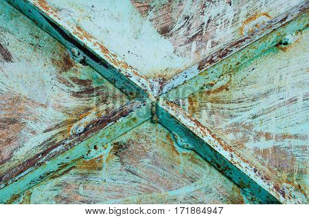 Texture background with a metallic form of the cross