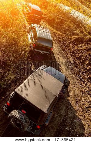 Off-road journey to the big SUV in sunlight