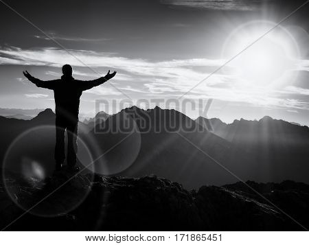 Lens Flare. Happy Hiker At Peak Of Mountain With Raised Arms