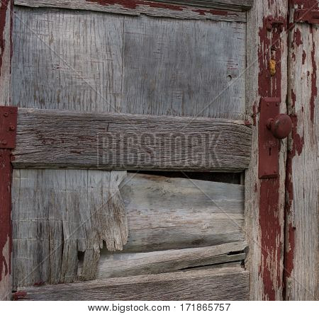 An old wooden with only touches of red paint remaining