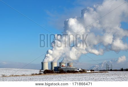 huge white smoke from factory in winter