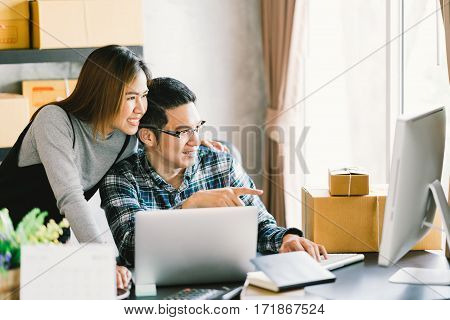 Young Asian couple startup family business online marketing packaging and delivery scene. SME entrepreneur business partner or freelance work at home concept