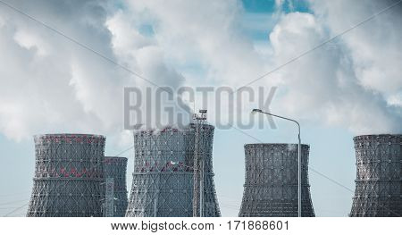 Nuclear power plant. Big cooling towers or pipes. Thick white smoke. Nuclear energy concept