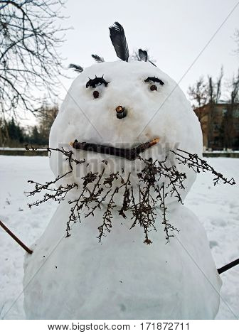 Snowman with a beard close-up made by the children in the city of Krivoy Rog in Ukraine