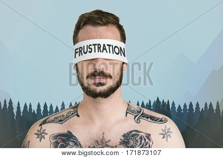 Caucasian man shirtless and blindfold with tattoo