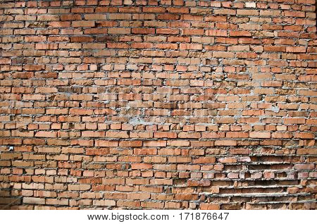 Texture of red brick damaged old wall