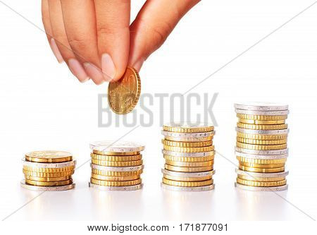 Successful investment concept. Euro coins and hand.