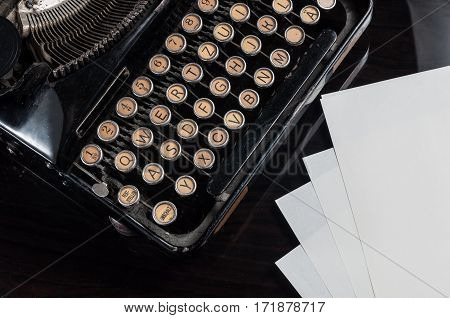 Retro Typewriter And Blank Sheets Of Paper