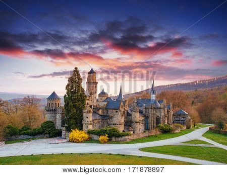 The picturesque sunset and cumulus clouds over the ancient castle. Germany Europe