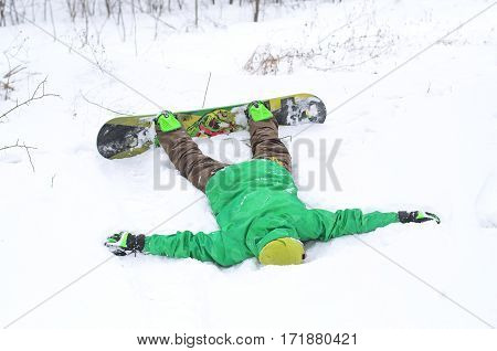 Man Snowboarder Lying In The Snow.