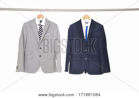 Set of two men's suits ,shirt on hanging
